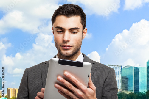Business man holding his tablet