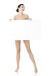 Leinwanddruck Bild - Sexy naked brunette holding empty board