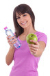 Young caucasian woman holding a bottle of water and an apple