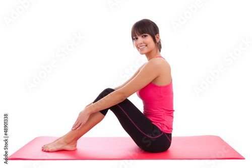 Beautiful caucasian fitness woman stretching