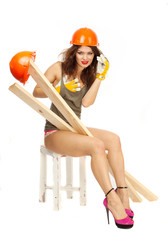 Half-naked girl in orange hard hat on a white background.