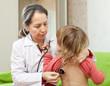 mature pediatrician doctor examining child