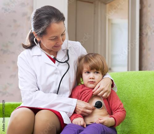 doctor examining 2 years baby