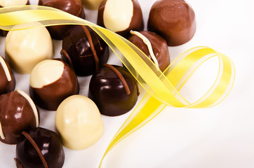 Assortment of chocolate candies with yellow ribbon