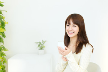 Beautiful young woman using a cellular