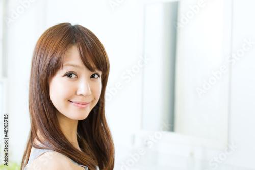 Beautiful asian woman relaxing in the bathroom