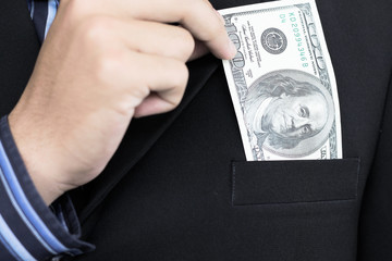 Businessman holding 100 dollars