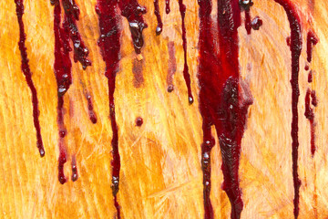 Rubber trees have turned red on a hardwood surface.