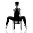 pretty young ballerina sitting on the chair. Rear view