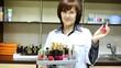 Woman-cosmetician represents nail polishes