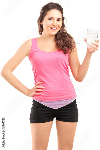 Sportswoman holding a glass of water