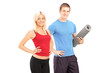 Young female and male athletes posing