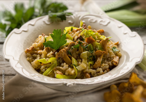 risotto with mushrooms and leek, selective focus
