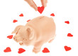 Cute piglet-piggy bank for the collection of hearts. Valentine's