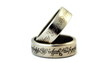 two silver wedding rings with engraved ancient inscriptions