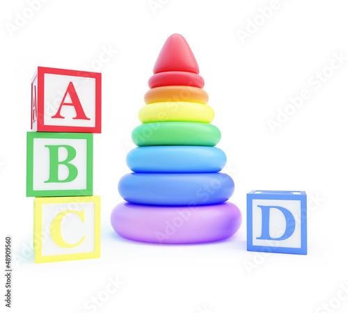 pyramid toy and alphabet blocks