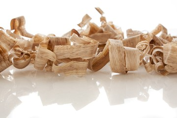 wood shavings over white background
