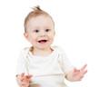 portrait of smiling baby boy isolated on white background