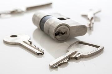 door lock with keys on white