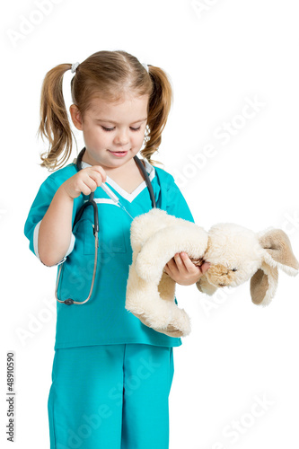 child girl with clothes of doctor with hare toy over white