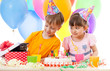 adorable children celebrate birthday party and opening gift box