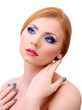 Beautiful young woman with glamour make up and manicure,