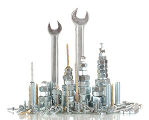 Many types of metal bolts, screws, nuts and wrenches isolated