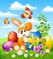 Easter bunny with easter eggs and butterflies
