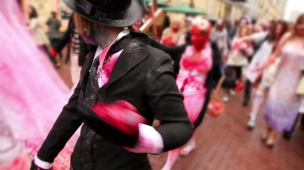 Bloody zombies crowd walk include newlyweds and bridesmaid