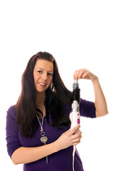 Woman with curling iron