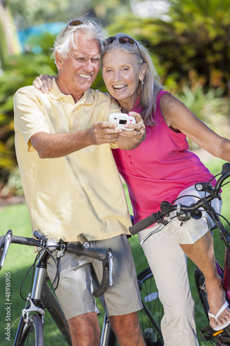 Senior Couple Bicycles Taking Digital Camera Picture