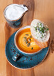 Pumpkin soup and toast with blue cheese and herbs