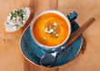Pumpkin soup with blue cheese  in a blue cup
