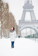 Winter in Paris. Happy young walking on Champ de Mars