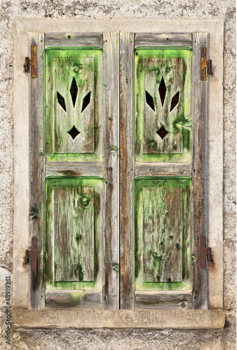 A Grungy old green wooden window