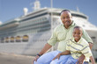 Happy Father and Son In Front of Cruise Ship