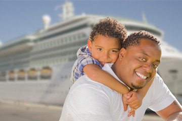 Mixed Race Father and Son In Front of Cruise Ship