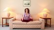 Woman sits on sofa in lotos pose, then closes her eyes and