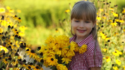 Close-up portrait of a girl with yellow flowers