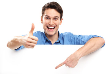 Man showing thumbs up with blank board