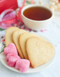 lemon cookies with sugar and cup of tea