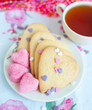 vanilla cookies with sugar and cup of tea