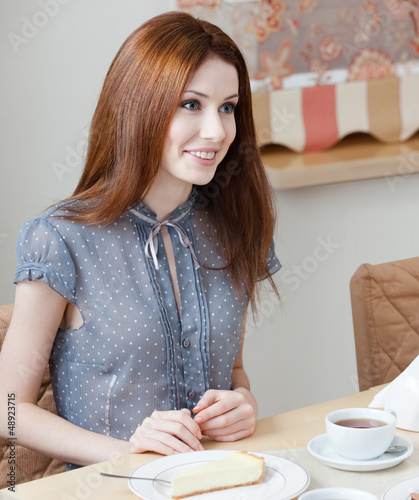 Woman talks with someone sitting at the table