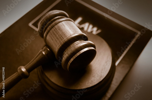 court gavel on top of a law book