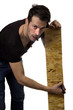 Man marking plank of wood