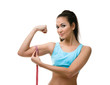 Sporty woman measures her bicep with measuring tape