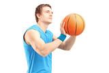 A young basketball player shooting basketball