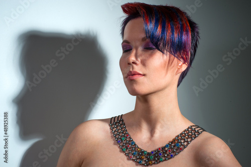 portrait of a beautiful girl with dyed hair, professional hair c