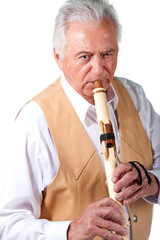 Elderly senior male playing native american flute