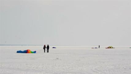 Snowkiting on a frozen lake